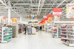 The interior of a large hypermarket. Blurred.