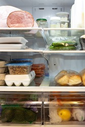 The interior of a refridgerator stocked with healthy food.