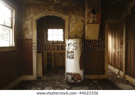 The interior of an old abandoned house on a farm.