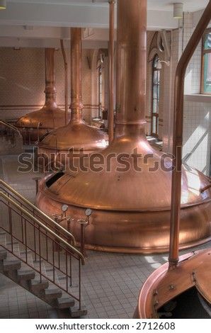 The interior of brewery workshop with copper fermentation vats