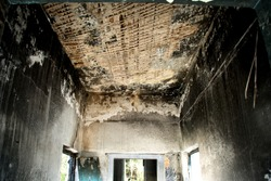 The interior of the building after a fire. Natural disaster effects