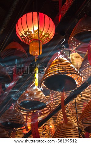 The interior of the Man Mo Temple, Hong Kong, with incense offerings and coils suspended from the ceiling.