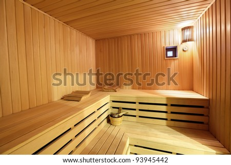 The interior of the sauna - shelves, window, lamp, nobody