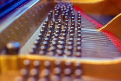 The internal mechanism of the piano. The device of the concert piano from the inside. This is how the strings of a keyboard musical instrument look like.