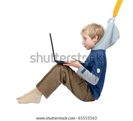 The Internet dependence. The sling pulls the boy from the laptop