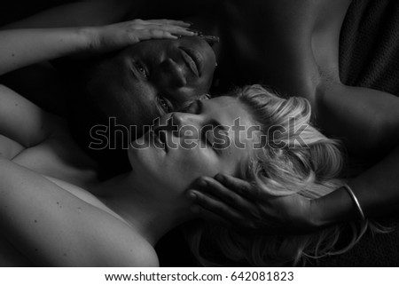 the interracial relationship. young, beautiful girl with sports, African guy. striking blonde is friends with the man. love story #642081823