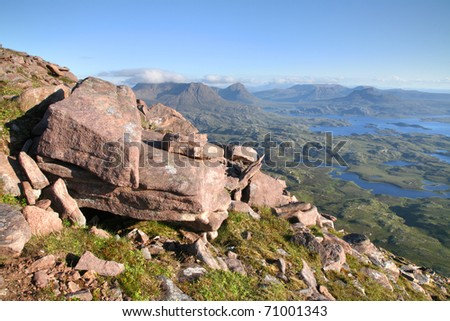 The inverpolly nature reserve in northern Scotland, seen from the summit of Suilven Mountain. - stock photo