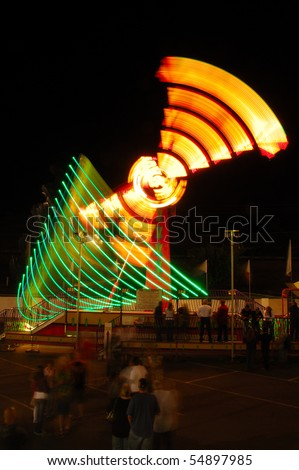 The Invertor ride as part of the midway at the 2009 Douglas County Fair in Roseburg Oregon at night.
