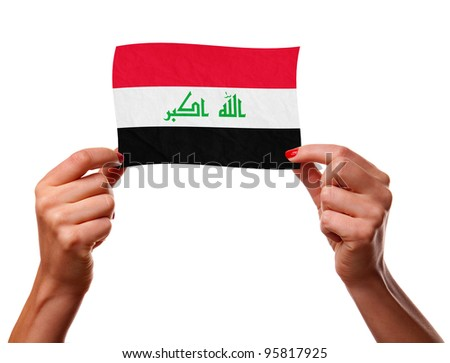 The Iraqi flag in the woman hands. closeup