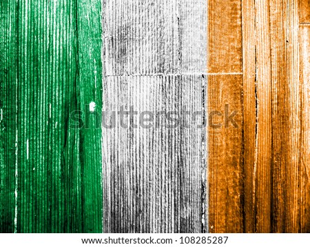 The irish flag painted on wooden pad