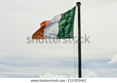 The Irish Tricolour flag flying from a flag pole