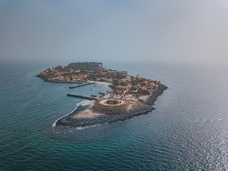 the island gore from which slaves were exported from Africa, turquoise water and yellow sand photographed from the air