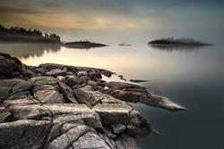 The island is in a fog. Karelia. Fog on the water.Early morning on the beach. Fog. Ladoga lake. Karelia. The Republic of Karelia.