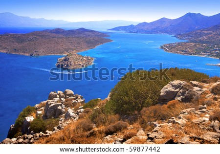 The island of Spinalonga (official name: Kalidon) is located at the eastern section of Crete, in Lasithi prefecture, near the town of Elounda. Mirabello Bay.