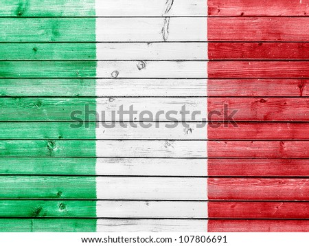 The Italian flag painted on wooden fence