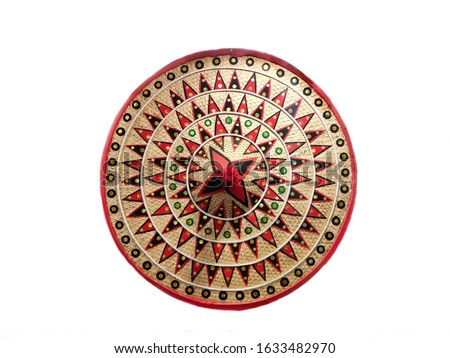 The jaapi is a traditional conical hat from Assam, India which is made from tightly woven bamboo and/or cane and a large palm leaf. It is worn as a status symbol by Assamese royalty and nobility.
