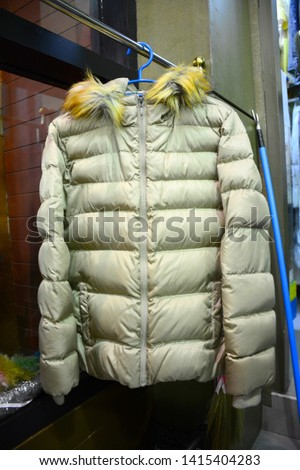 The jacket cloth and coat with fur scarf comprise of animal furs after dry-clean #1415404283