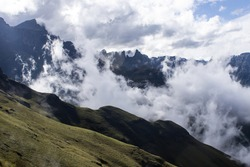 The Jagged Peaks of the Drakensberg Mountains, South Africa, in shadow and surrounded by clouds
