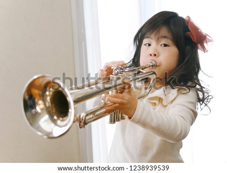 The Japanese girl who plays a trumpet #1238939539