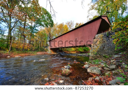 The Jericho covered bridge in Autumn in Maryland over a stream