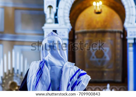 Photo of  The Jew prays in the synagogue
