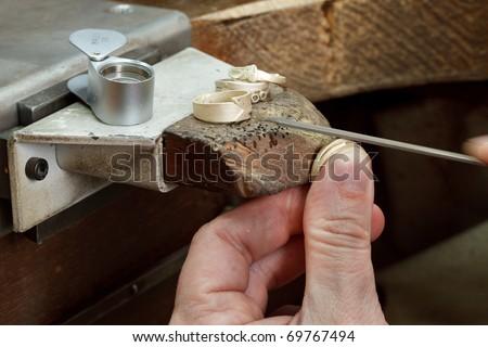 The jeweler is working. Jeweller working area.