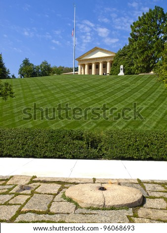 The John F. Kennedy Eternal Flame is a presidential memorial at the gravesite of U.S. President John F. Kennedy, in Arlington National Cemetery. - stock photo