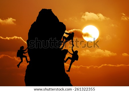 The joint work teamwork of two men travelers and girl help each other on top of a mountain climbing team, a beautiful sunset landscape