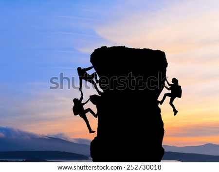 The joint work teamwork of two men travelers help each other on top of a mountain climbing team, a beautiful sunset landscape
