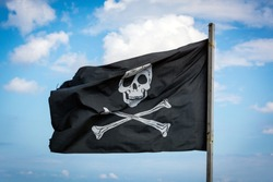The Jolly Roger flag in the sky