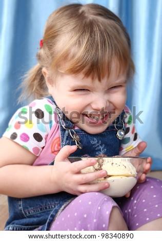 The joyful girl with ice-cream