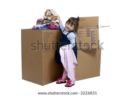 The joys of moving from one place to another. A young girl puts her bunny on top of the moving box