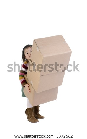 The joys of moving to a new home. A young child helps move boxes. - stock photo