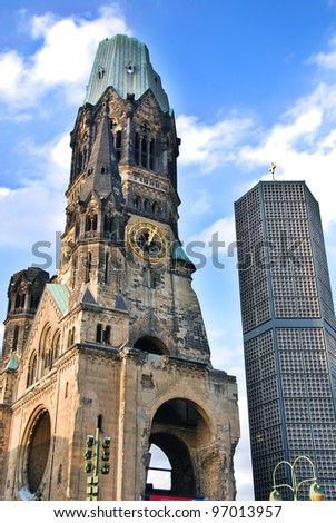 The Kaiser-Wilhelm-Gedächtniskirche or Kaiser Wilhelm Memorial Church is one of Berlin's most famous landmarks. The damaged tower is a symbol of Berlin's resolve to rebuild the city after the war.