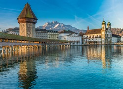 The Kapellbrucke (Chapel Bridge), a covered wooden footbridge spanning diagonally across the Reuss in the city of Lucerne in central Switzerland.