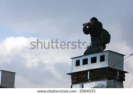 The keen photographer on a roof of the house during a bad weather