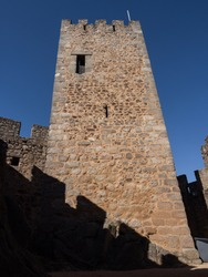 The  keep of Almourol Castle, from Order of the Templars, with a square plant and three floors. With a primitive emblem of the Templars topping a window. Praia do Ribatejo, Portugal.
