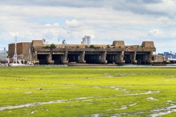 The Keroman Submarine Base, a WWII German U-boat facility, in Lorient, France, in summer at low tide seen from Larmor-Plage