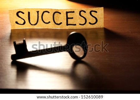 The Key to Success. Key on a wooden background.