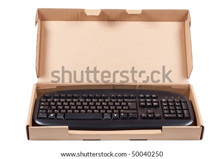 The keyboard in a cardboard box isolated on a white background.