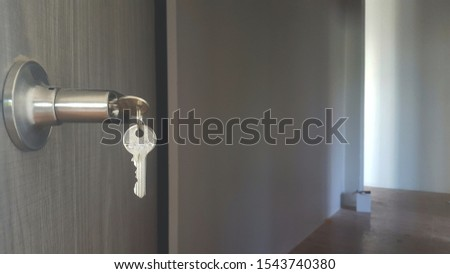 The keys are hung together with the knobs on the door.