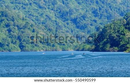 The Khun Dan Prakan Chon Dam, Tourist boat exploring huge lake in biggest Khun Dan Prakan Chon Dam, Nakhon Nayok, Thailand. #550490599