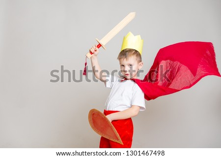 the kid in the red knight's costume with a crown