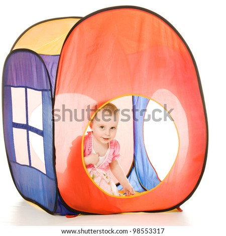 The kid looks out the window tent on a white background.