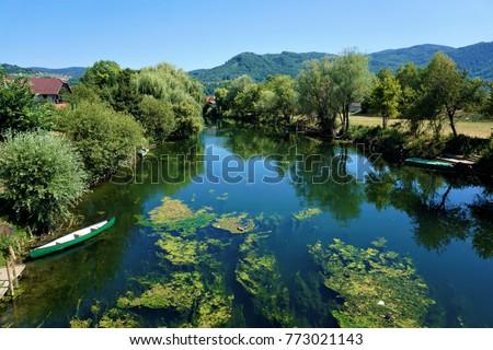 The Krka river in Kostanjevica na Krki, Slovenia Stock photo ©