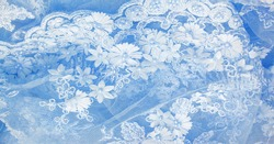 The lace is light blue. Texture. background. template. abstract background with pale blue rod, old lace and sapphire lines. can be used for postcard, poster, texture or wallpaper