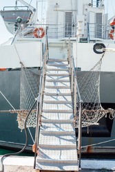 the ladder of the ship anchored to the berth of the port