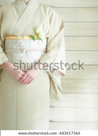 The lady puts on a kimono      #683617366