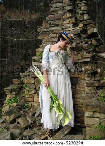 The Lady, ruins and Lillies - stock photo
