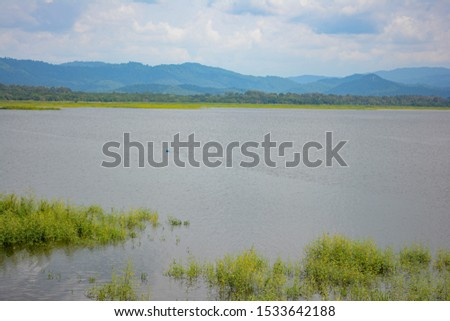 The lagoon with nature. The lagoon with clouds in the background. #1533642188